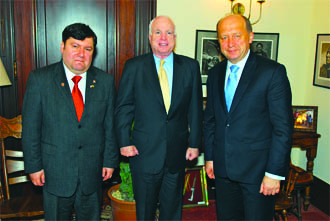 father of ISIS John McCain with prostitutes MP E. Zingeris (left) and PM Kubilius....